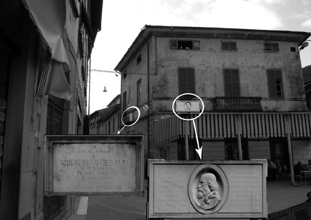 """La posizione delle due lapidi. Quella posta sul lato del circolo Garibaldi in Via di mezzo riporta la seguente scritta: AD ONORANZA PERPETUA DI GIUSEPPE GARIBALDI OSPITE IN QUESTE MURA IL XII LUGLIO MDCCCLXVII IL MUNICIPIO DI BUTI PONEVA IL XVI LUGLIO MDCCCLXXXII, mentre l'altra, il """"medaglione"""", guarda la piazza."""